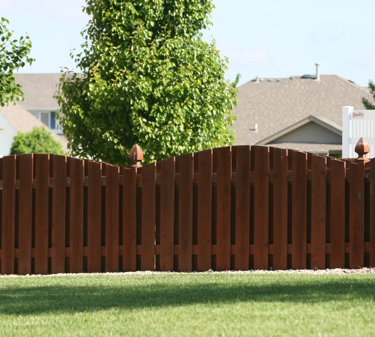 AFC Sioux City - Wood Fencing, 1002 4' overscallop picket stained