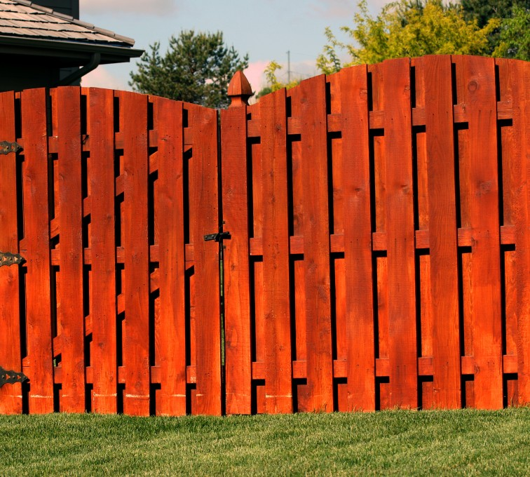 AFC Sioux City - Wood Fencing, 1014 6' overscallop board on board stained 4