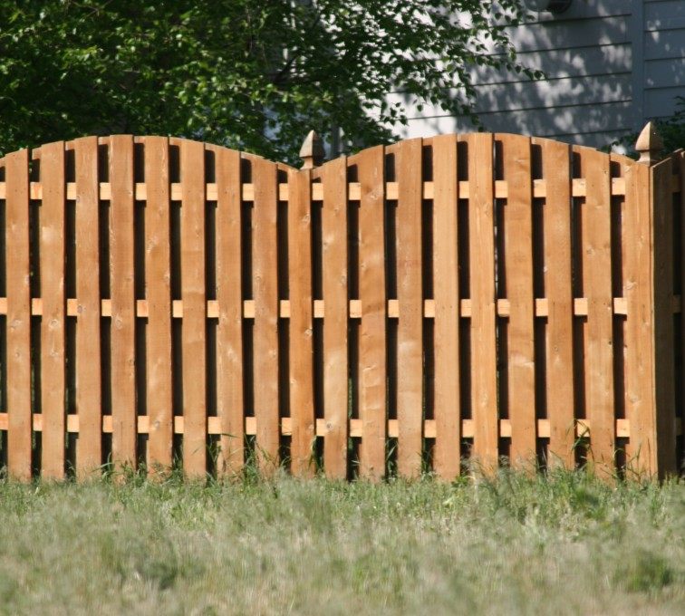 AFC Sioux City - Wood Fencing, 1015 6' overscallop board on board stained