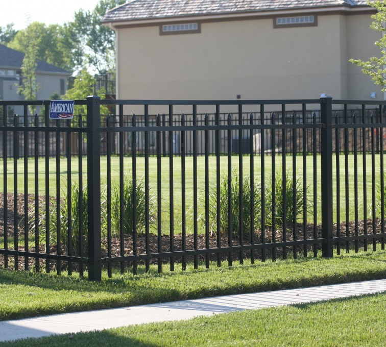AFC Sioux City - Ornamental iron flat top fence with alternating pickets