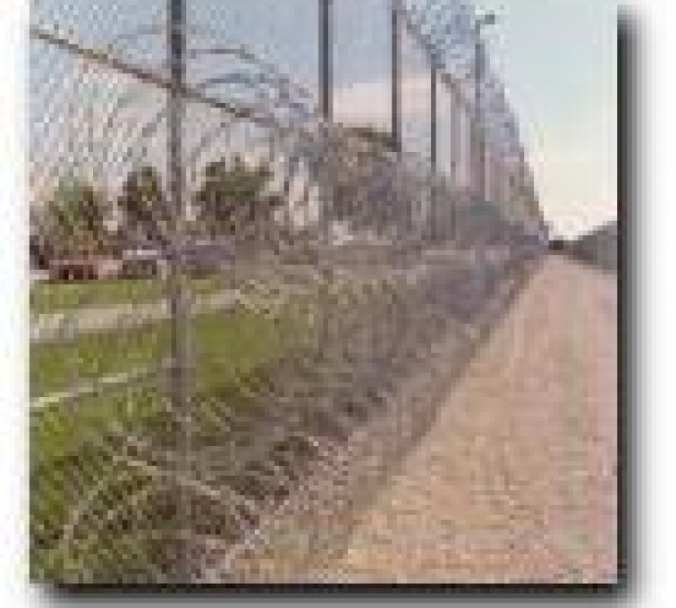 AFC Sioux City - 3 coils of razor wire on a high security fencing