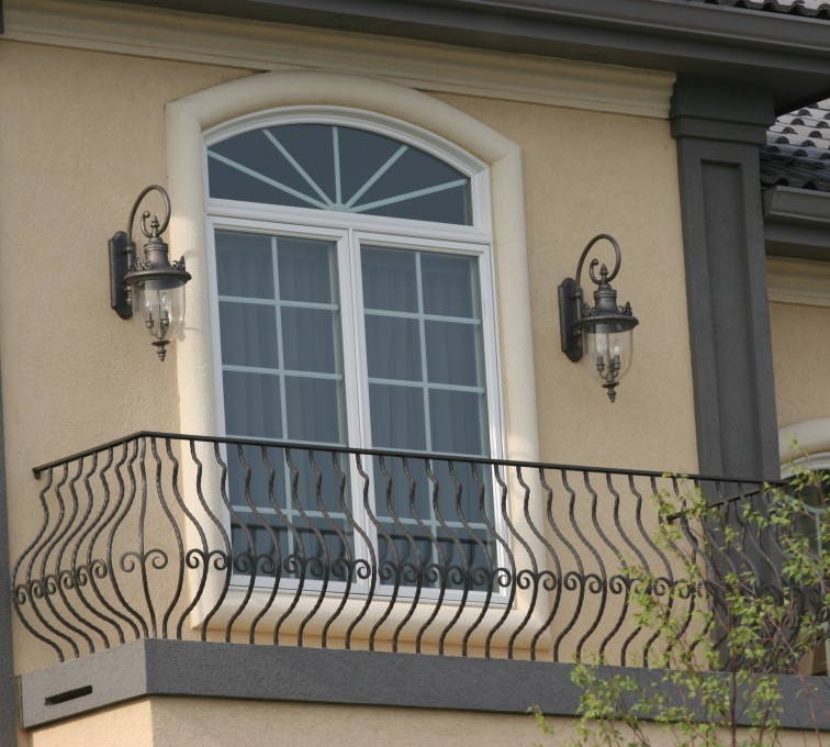AFC Sioux City - Custom Balcony railing with pot belly pickets