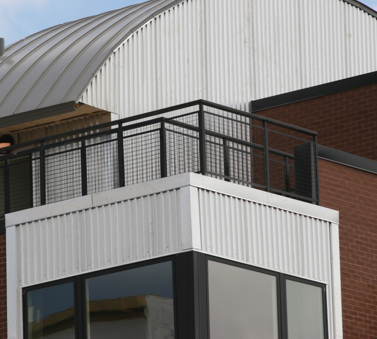 AFC Sioux City - Railing with custom mesh infill