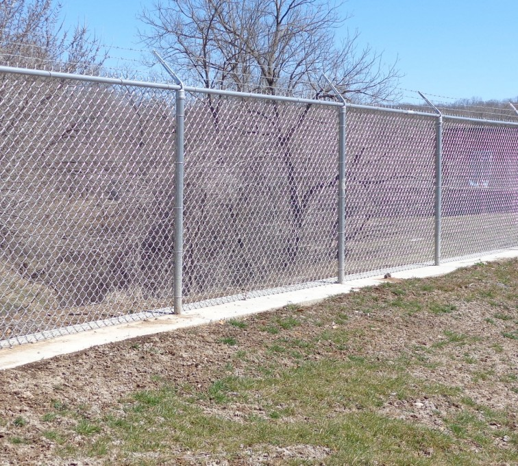 AFC Sioux City - Sports Fencing, galvanized chain link with barb wire