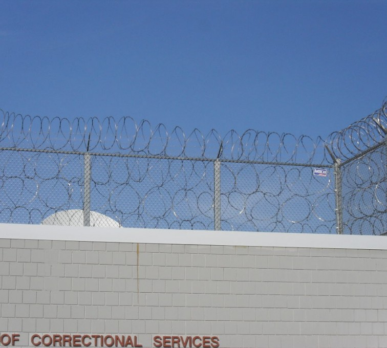 AFC Sioux City - Four Stack Concertina Wire on a Prison Fence
