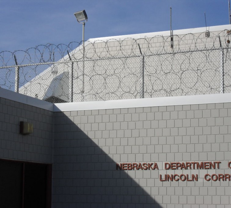 AFC Sioux City - Prison fence with concertina wire