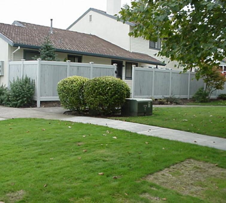 AFC Sioux City - Greystone Solid PVC Fence