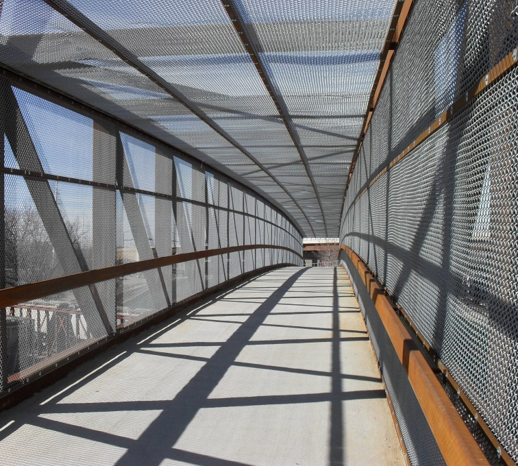 AFC Sioux City - Inside of a bridge completely encapsulated by chain link