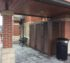 AFC Sioux City - Brown horizontal louver enclosure with swing gate