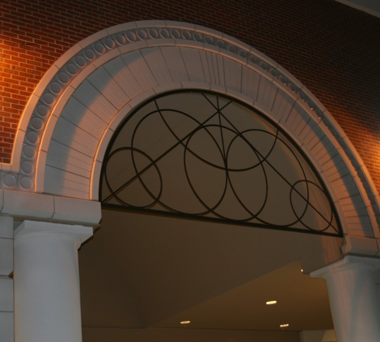 AFC Sioux City - Decorative metal screening for doorway arch