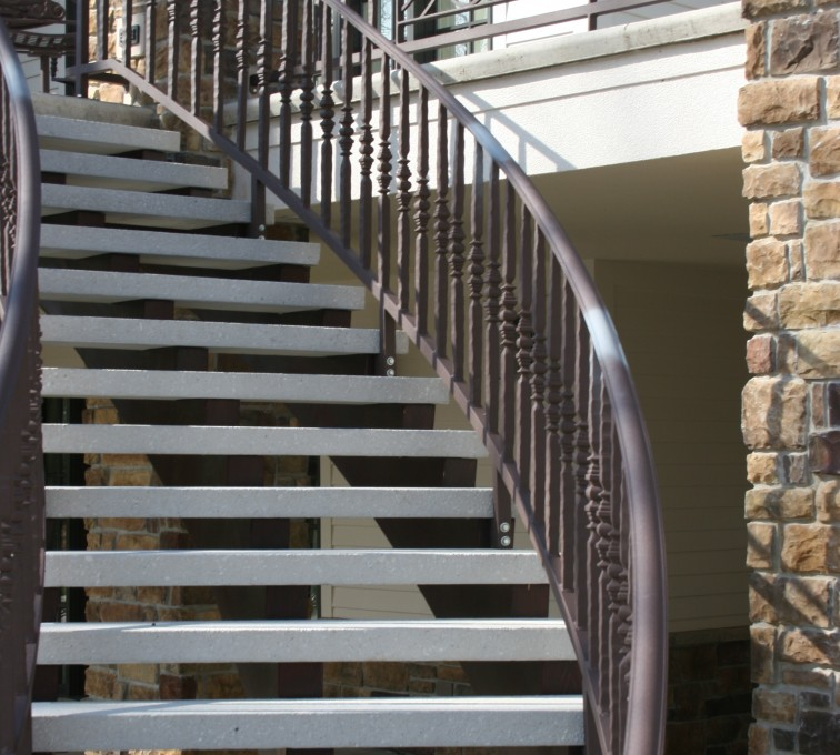 AFC Sioux City - Custom Brown Ornamental Iron Curved Staircase Railing
