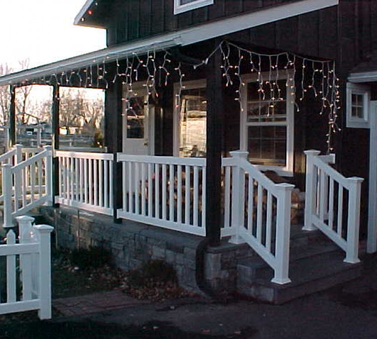 AFC Sioux City - Home with white railing and holiday lights