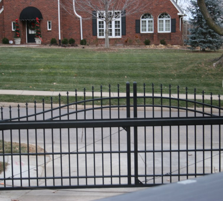 AFC Sioux City - Custom Over Arch Cantilever Gate