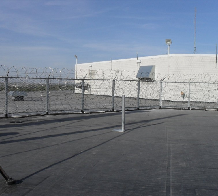 AFC Sioux City - Rooftop high security fencing with concertina wire