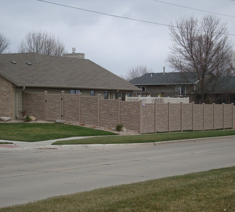AFC Sioux City - Stone Accent Solid Vinyl Fence