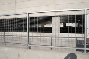 A head on shot of a bar grating system that is installed in a parking garage