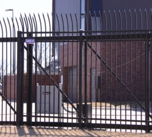 An automatic ornamental sliding gate featuring a gate operator and access portal