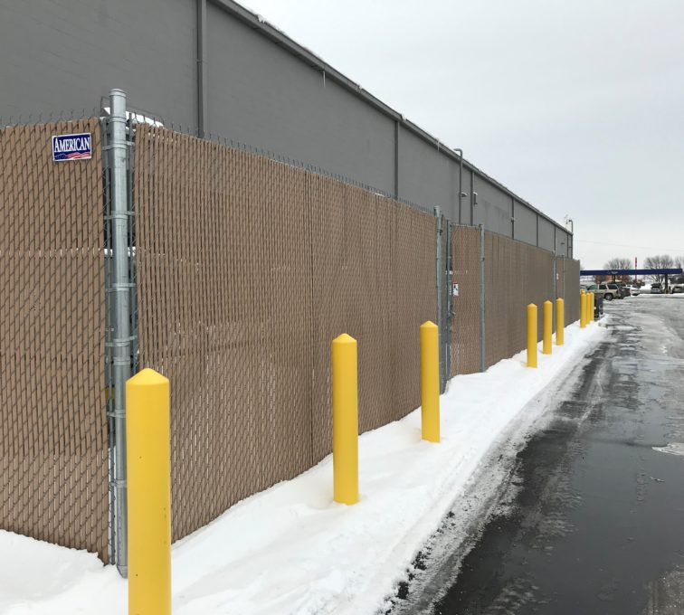 American Fence Company of Sioux City commercial chain link fence with brown privacy slats