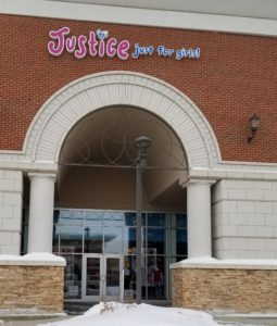 A Justice store in Sioux City with a custom ornamental top piece to the entrance