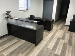 American Fence Company of Sioux City office with new furniture, flooring and wall treatments