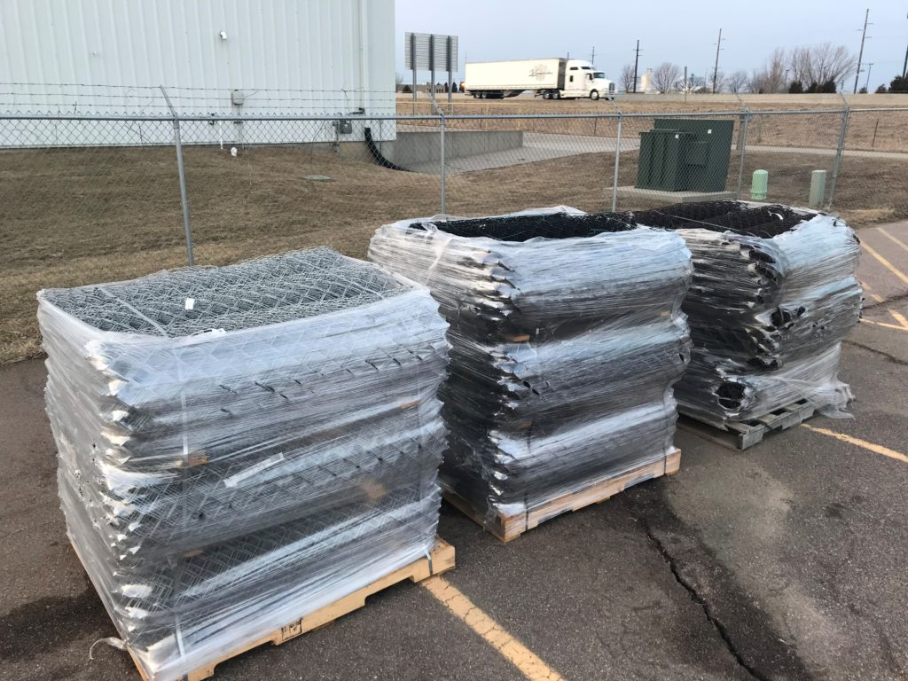 Pallets of brand new rolls of chain link fence in Sioux City, Iowa